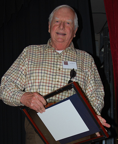 Tom Wyman receiving plaque